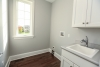 laundry room, sink, gray walls, hardwood flooring, window, new home