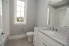 guest bathroom, window, gray paint, white vanity,