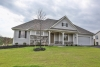 front of house, green grass, cloudy sky, gray house