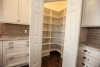 new ranch for sale walk-in pantry with lighting, white kitchen