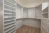 Master walk-in closet at new home for sale in Pittsford