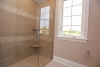 """Curbless master shower with rounded shower shelves, personal shower and 1/2"""" glass door in master bath at Campden Ranch in Pittsford"""