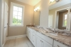 Master bathroom at Campden Ranch in Pittsford, granite counters, white cabinetry, window, square mirrors