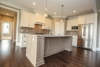 custom home in pittsford with white kitchen and touches of beige and gray