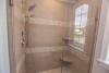 master shower, tiled walls and floor, glass doors, first floor living, handicap accessible