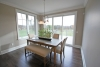 Dining room, nice windows and doors that go out to deck and green space