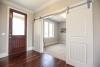 flex room, barn doors, hardwood flooring, foyer