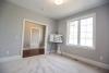 flex room, carpet, hardwood flooring, foyer