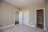 guest bedroom, carpet, white doors and trim, access to full bathroom, new home in pittsford
