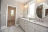 master bathroom, henley ranch, round mirrors, white cabinetry, gray counters