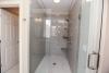 master bathroom water closet, curbless shower, glass doors