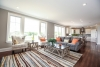 great room, open floor, designer rug, orange pillows, windows, new home for sale in pittsford