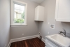 laundry room, gray walls, sink, white cabinetry, new construction pittsford