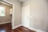 back hall at new model home in pittsford, gray walls, warm hardwood flooring