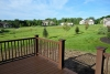 view of henley ranch deck and surrounding green space